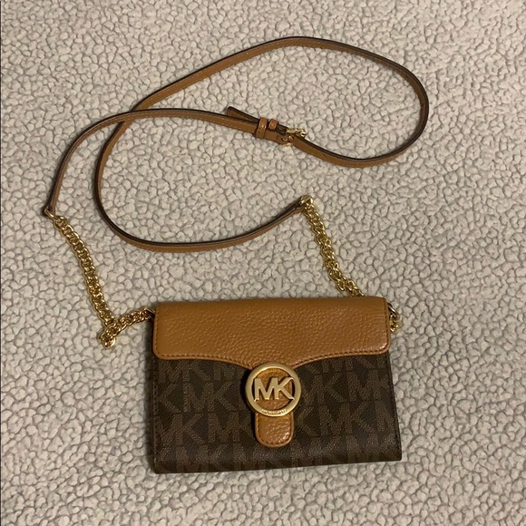 97d9399b533d Michael Kors Vanna Large Phone Crossbody Wallet.  M_5c267c9c0cb5aae440a0b525. Other Bags you may like. Authentic Michael Kors  Leather Shoulder Bags